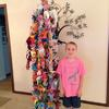 Will Baird posing with the thousands of origami cranes to wish Susan health and happiness